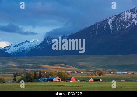 The agricultural and ranching area near Joseph, Oregon lies below the Wallowa Mountains. spring. USA - Stock Photo