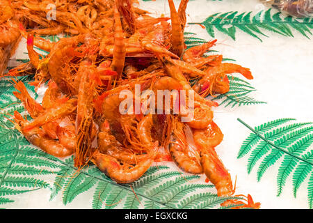 Fresh shrimps for sale at a market - Stock Photo