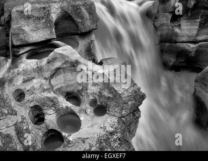 Potholes carved by river. Lower Sunwapta Falls. Jasper National Park, Alberta, Canada - Stock Photo