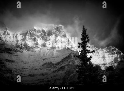 First light on mountain, surrounding Moraine lake with fresh snow. Banff National Park, Alberta, Canada - Stock Photo