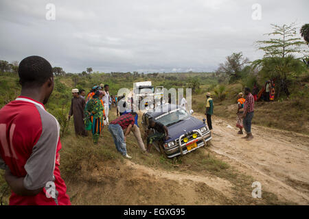 Disabled vehicles on an impassible road near Tanga, Tanzania, East Africa. - Stock Photo