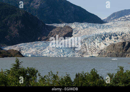 Mendenhall Glacier is a tidewater glacier terminating in Mendenhall lake some 16 miles from downtown Juneau, Alaska's - Stock Photo