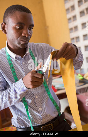 Artisans design hand-made bags in a workshop in Dar es Salaam, Tanzania, East Africa. - Stock Photo