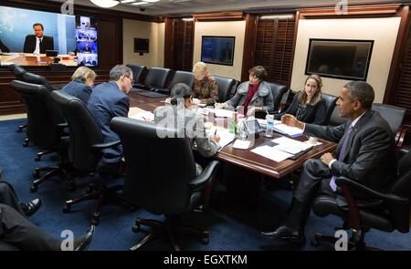 US President Barack Obama participates in a secure video teleconference with foreign leaders to discuss Ukraine - Stock Photo