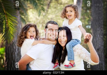 parents and children, happy smiling hispanic family - Stock Photo