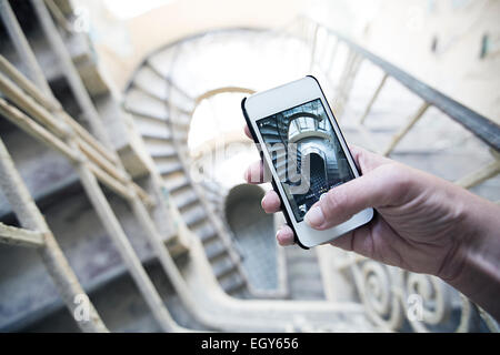 Woman's hand holding smartphone taking a picture - Stock Photo