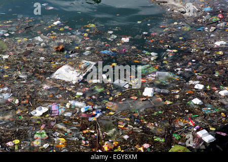 Plastic bottles and other trash in ocean at Semporna, Borneo - Stock Photo