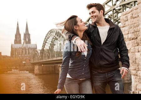 Germany, Cologne, happy young couple on city tour - Stock Photo