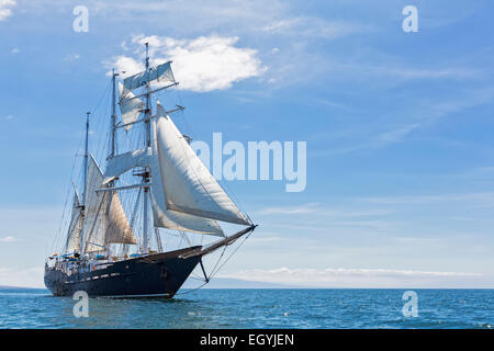 Pacific Ocean, sailing ship under sail at Galapagos Islands - Stock Photo