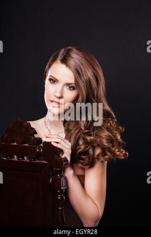 beautiful woman model with perfect makeup and flying hair wearing jewelry - Stock Photo