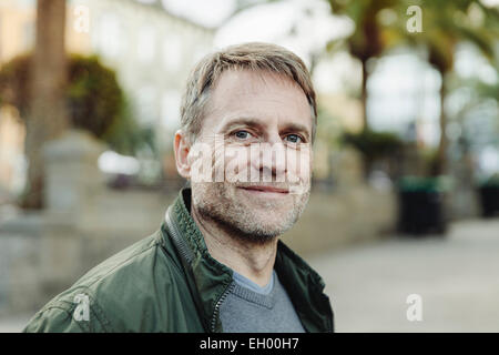 Spain, Canary Islands, Gran Canaria, portrait of smiling mature man - Stock Photo