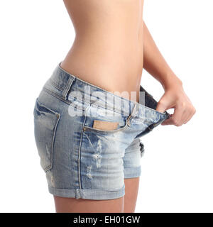 Closeup of a woman waist weight loss diet concept isolated on a white background - Stock Photo