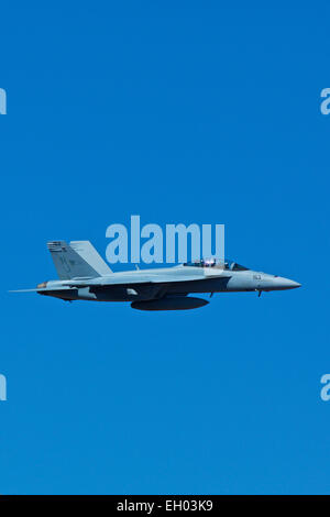 Close Up Profile View Of A US Navy F/A-18F Super Hornet Jet Fighter Flting In The Skies Above California. - Stock Photo