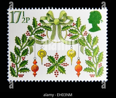Postage stamp. Great Britain. Queen Elizabeth II. 1980. Christmas. Holly. - Stock Photo