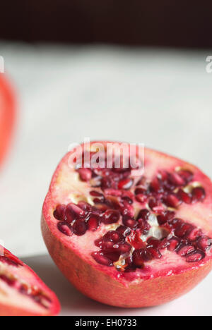 Still life food image of a Pomegranate cut in half - Stock Photo