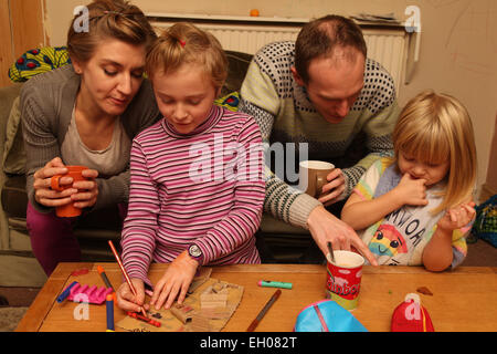 Parents and children crafting - Stock Photo