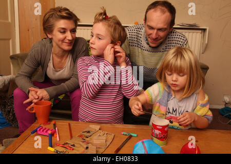 Parents and children crafting - model released - Stock Photo