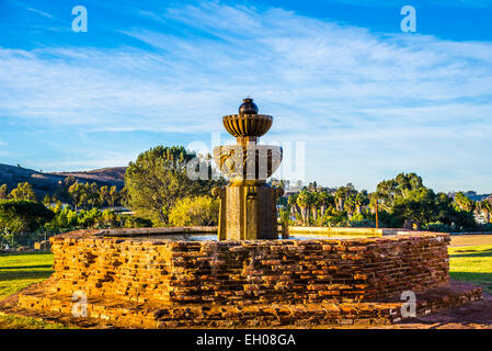 The fountain in front of the Mission San Luis Rey De Francia (founded 1798). Oceanside, California, United States. - Stock Photo