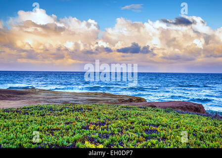 View of clouds over the Pacific Ocean from a viewpoint above Sunset Cliffs Natural Park, California, United States. - Stock Photo