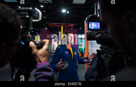NASA Astronaut Reid Wiseman is interviewed by media at the Maryland Science Center during a visit to his hometown - Stock Photo