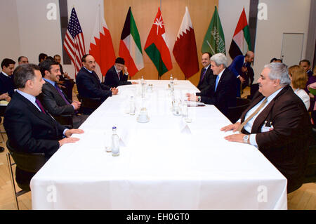 U.S. Secretary of State John Kerry sits with members of the Gulf Cooperation Council -- clockwise from bottom left, - Stock Photo