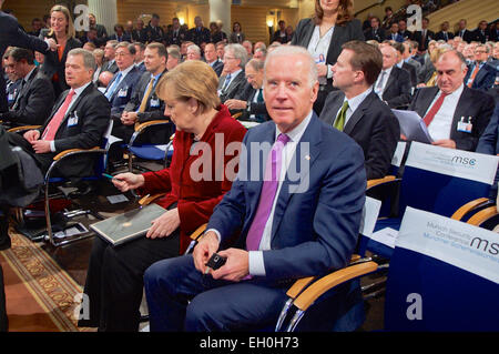 Vice President Joe Biden sits with German Chancellor Angela Merkel before she speaks and takes audience questions - Stock Photo