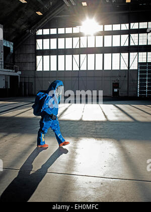 A National Guardsman in nuclear radiation suit walks along at an air base in South Dakota. - Stock Photo