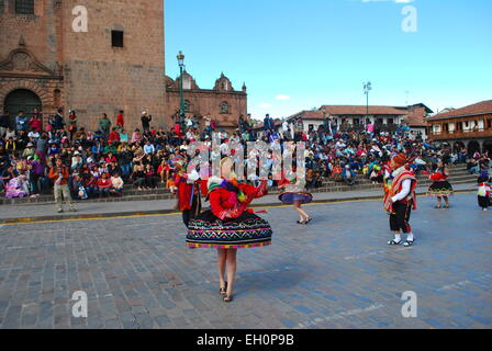 Locals performing in traditional dress at a religious festival in the Plaza de Armas, Cusco, Peru - Stock Photo