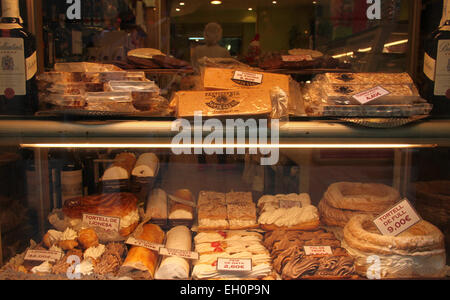 Traditional cakes, pastries and turron in shop window, Barcelona, Catalonia, Spain - Stock Photo