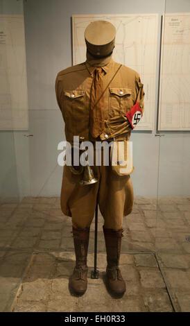 Uniform of SA Nazi  brownshirt paramilitary man at Sachsenhausen concentration camp - Stock Photo