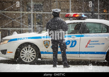 NYPD police officer in Manhattan in New York North America USA - Stock Photo
