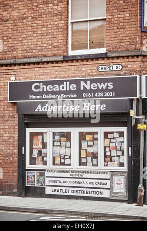Cheadle Village newsagent Cheadle News in Stockport with a frames outside - Stock Photo