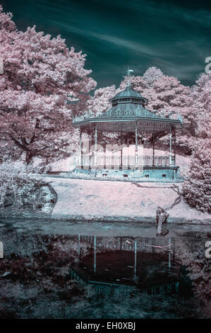 Infrared landscape photograph of Sefton Park's band stand in Liverpool, UK. - Stock Photo