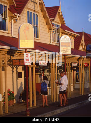 Tourist information and tour booking building at sunset, Paihia, Bay of Islands, Northland Region, North Island, - Stock Photo