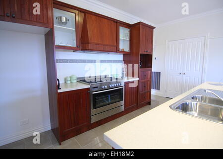 Modern Kitchen with wooden cabinets - Stock Photo