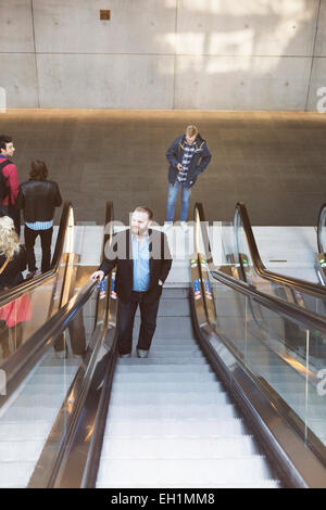 High angle view of business people on escalator at subway station - Stock Photo
