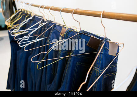 Jeans hanging from rack in factory stock photo 79329885 for Thill s fish house