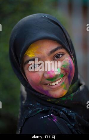 Dhaka, Bangladesh. 5th March, 2015. Muslim girl attended Dol Festival wearing hijab with their friend.The Dol Utsav, - Stock Photo