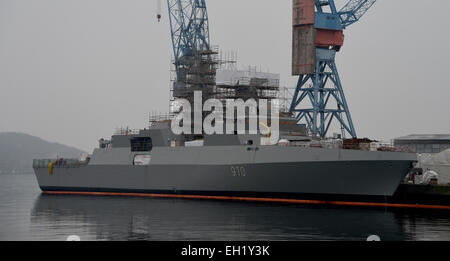 Kiel, Germany. 12th Feb, 2015. A frigate, destined for the Algerian Navy, is docks at the pier in the shipyard of - Stock Photo