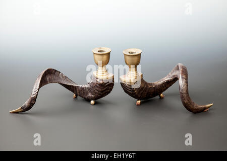 Pair of vintage brass ram horn candle holders. - Stock Photo