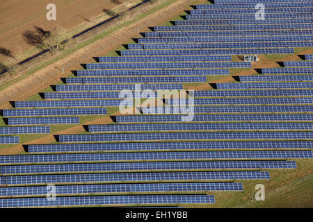 a close-up aerial view of solar panels (pv cells) on a solar farm in the UK - Stock Photo
