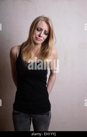 tearful young woman - Stock Photo