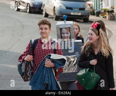 Group of teenagers two in fancy dress for a charity dress - Stock Photo