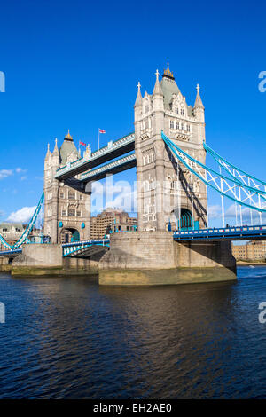 The beautiful architecture of Tower Bridge under a clear blue sky in London. - Stock Photo