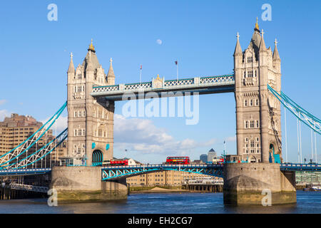 A beautiful view of Tower Bridge under a clear sky in London.  Docklands can also be seen in the distance. - Stock Photo