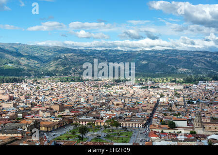 Cityscape view of Cajamarca, Peru and the surrounding hills with the Plaza de Armas visible at the bottom - Stock Photo
