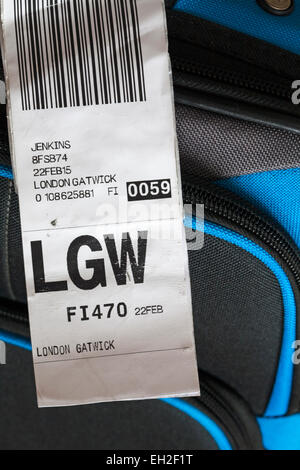 luggage label stuck on case for LGW London Gatwick airport - Stock Photo