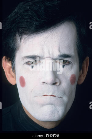 Mime, male, in white face, displaying anger, resentment - Stock Photo
