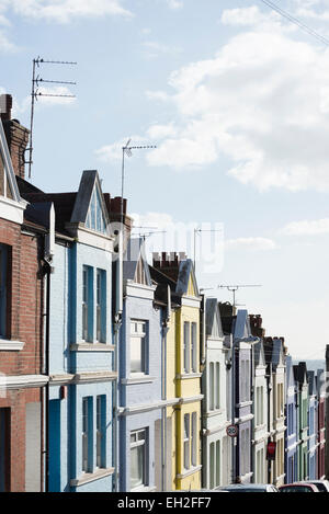 Terraced houses on a hill in Brighton, England, UK - Stock Photo