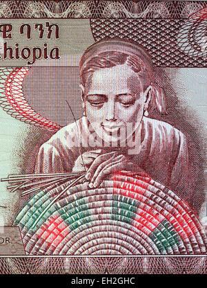 Woman weaving basket from 10 birr banknote, Ethiopia, 2008 - Stock Photo